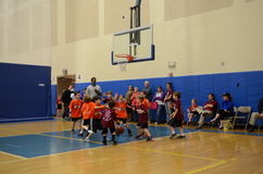 Kids playing basketball. Young kids playing basketball match in an indoor court in San Antonio, Texas Stock Photo
