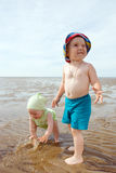 Kids playing at the beach . Stock Images