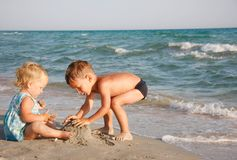 Kids playing on beach Stock Photo