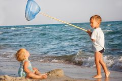 Kids playing on beach Royalty Free Stock Images