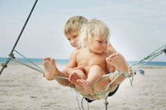 Kids playing on beach Stock Images