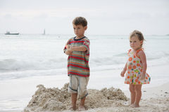 Kids playing on beach Stock Photography