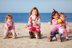 Kids playing at the beach Royalty Free Stock Photos