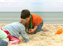 Kids playing at the beach Stock Photos