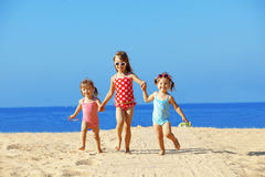 Kids playing at the beach royalty free stock image