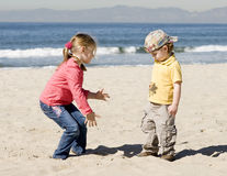 Kids are playing on beach Stock Photography
