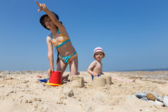 Kids playing on the beach Stock Photography