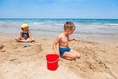 Kids playing on the beach royalty free stock photos