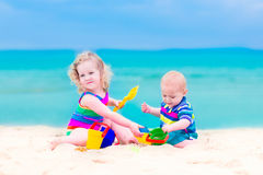 Kids playing on the beach Royalty Free Stock Image