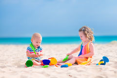 Kids playing on the beach Royalty Free Stock Images