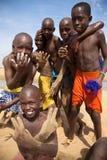 Kids playing on the beach of Saint Louis. SAINT LOUIS, SENEGAL, DECEMBER 17: Unidentified group of Kids playing on the beach and smiling, Senegal, December 17 Stock Image
