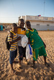 Kids playing on the beach of Saint Louis. SAINT LOUIS, SENEGAL, DECEMBER 17: Unidentified group of Kids playing on the beach and smiling, Senegal, December 17 Royalty Free Stock Image