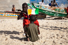Kids playing on the beach of Saint Louis royalty free stock photography