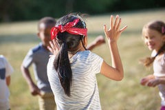 Kids playing blind man's buff Royalty Free Stock Photo