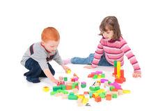 Kids playing with blocks Stock Photo