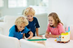 Kids playing board game. Toys for children stock image