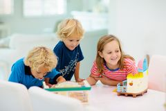 Kids playing board game. Toys for children royalty free stock photo