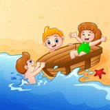 Kids playing boat around water on seashore Royalty Free Stock Images