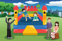 Kids playing in a bouncy house Royalty Free Stock Image