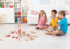 Kids playing with bow and arrow at home Stock Photo