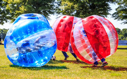 Kids Playing Bubble Soccer stock images