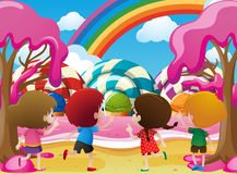 Kids playing in candyland Stock Image