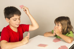 Kids playing cards. At home Stock Photos