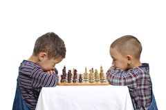 Kids Playing Chess. Two brothers aged 4 and 5 years playing a game of chess Stock Image