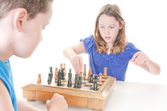 Kids playing chess. Children playing chess board game Royalty Free Stock Photo