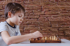 Kids playing chess. Kids playing a game of chess. Game, education, lifestyle concept Royalty Free Stock Images