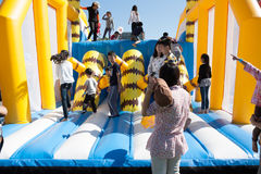 Kids playing at children inflatable playground royalty free stock photos