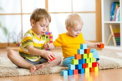 Kids playing in children room Royalty Free Stock Images