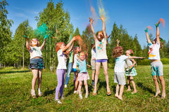 Kids playing with colored powder at outdoor fest Royalty Free Stock Photography