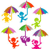 Kids playing with colored umbrellas Royalty Free Stock Photography