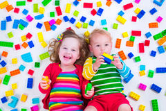 Kids playing with colorful blocks Stock Image