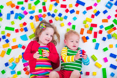 Kids playing with colorful blocks Royalty Free Stock Images
