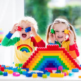 Kids playing with colorful blocks Stock Photography