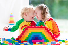 Kids playing with colorful blocks Royalty Free Stock Photos