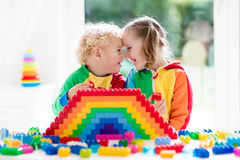 Kids playing with colorful blocks Royalty Free Stock Image