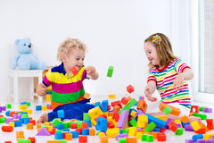 Kids playing with colorful blocks. Stock Image