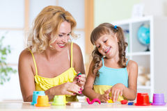 Kids playing with colorful clay molding different Royalty Free Stock Photo