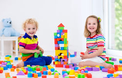 Kids playing with colorful toy blocks Royalty Free Stock Photography