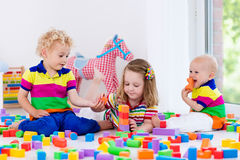 Kids playing with colorful toy blocks Royalty Free Stock Photos