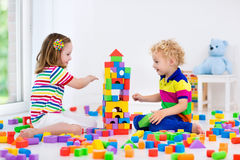 Kids playing with colorful toy blocks Royalty Free Stock Image