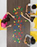 Kids playing colorful toys royalty free stock photo