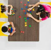 Kids playing colorful toys royalty free stock images