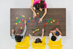 Kids playing colorful toys stock images