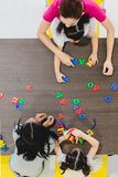 Kids playing colorful toys royalty free stock image