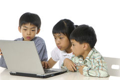 Kids playing computer Royalty Free Stock Images