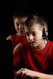 Kids playing computer game. In darkness Stock Photos